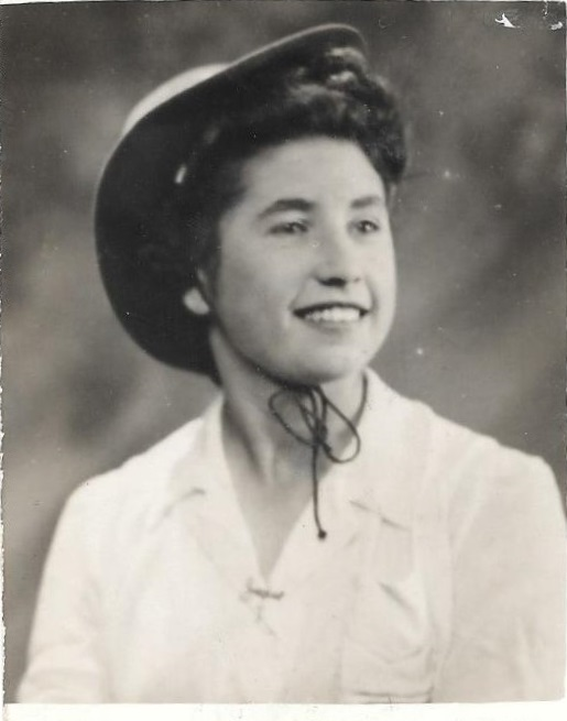 Image of sister Joan wearing a hat and smiling