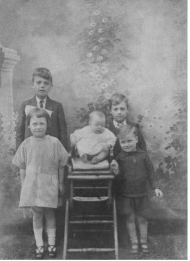 Ronald, front right with Norman directly behind. Brother Harold back left, sister Letty front left and sister Jean centre.