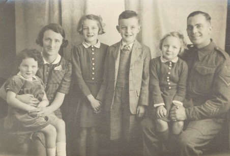 Robert with his family on leave prior to the Normandy invasion: Left to right Jean, our mother Elsie, Doreen, David and Beryl