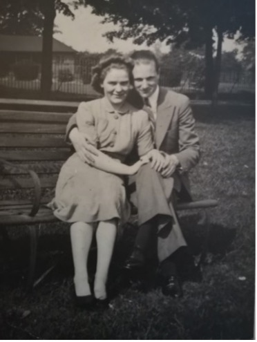 Ronald and Alice sitting on a bench outside