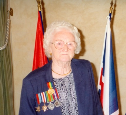 Robert's wife Elsie pictured wearing Robert's medals on the 50th anniversary of D-Day
